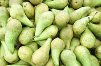 Green pears at a famers market in supermarket