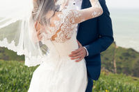 Groom kissing the bride in a wedding dress an oceanfront