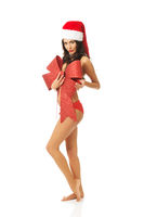 Santa woman standing and covering her body by ribbon, looking like a gift