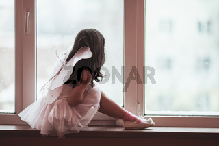 Dreamy girl at the window