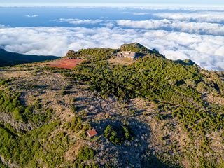 Abandoned House on Top Mountain Above the Clouds