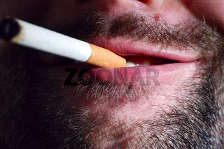 unshaven smoker