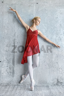 Ballerina on concrete wall background