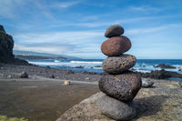 colourful yoga stones at the beach at azores
