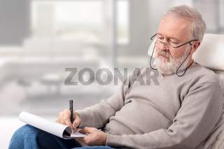 Man making the shopping list for holidays