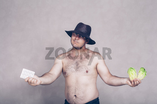 Naked corpulent man giving pharmaceuticals and vegetable