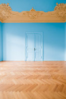 empty room with blue wall, stucco ceiling and parquet floor  -