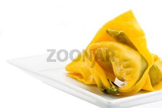 single tortelloni noodle on a white plate
