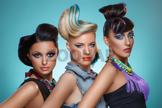 Beautiful girls with fancy hairstyles and vivid makeup