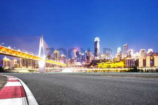 empty asphalt road with modern bridge and modern city