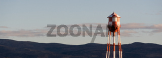Red White Checkered Water Tower Mountain Background