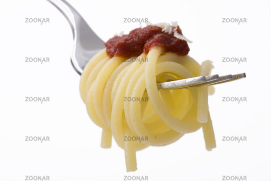 spaghetti on a fork over white background