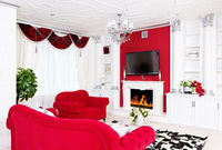 Classical living room white interior with fireplace and beautiful curtains
