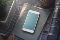 Mockup of white smartphone on the table. Clipping path