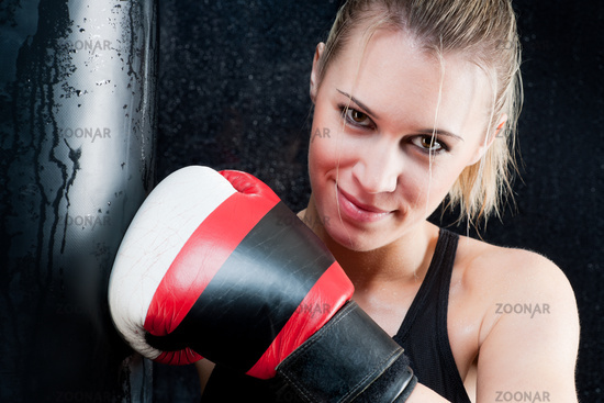 Boxing training woman with gloves in gym