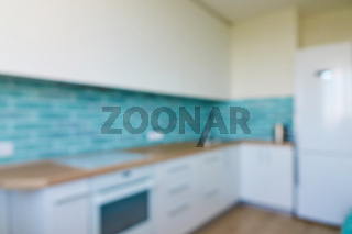 Blurred interior background kitchen in house