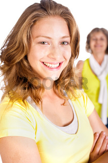 Gorgeous woman in focus with her mom in the background
