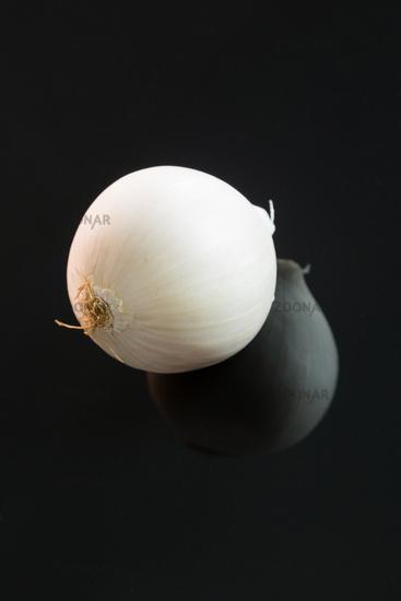 Three whole fresh raw white onions