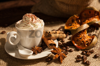 Close-up of coffee with whipped cream and cocoa powder