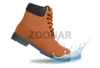 Brown boot and water splash. Side view