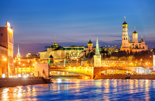 Moscow Kremlin glowing in the evening light over Moskva River, Russia