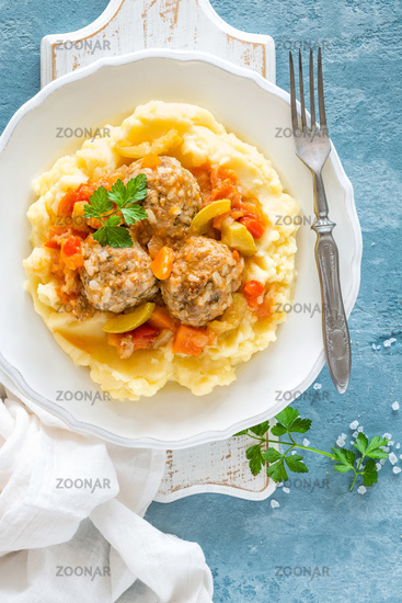 Meatballs in vegetable sauce with mashed potato, top view