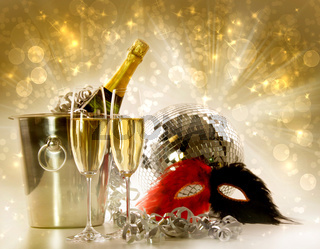 Two glasses of champagne against festive gold background