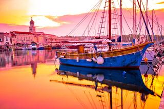 Historic island town of Krk golden dawn waterfront view