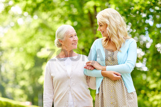 daughter with senior mother at park