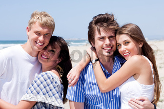 romantic young couples enjoying vacation in the beach