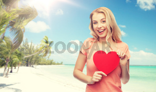 happy woman or teen girl with red heart shape