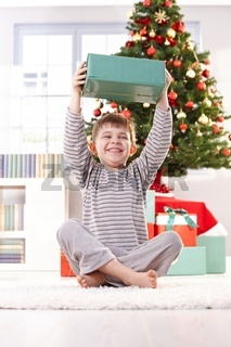 Small boy laughing with christmas present