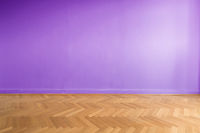 purple colored wall in empty room  with wooden floor -