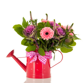 Watering can with bouquet flowers