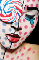 Face art with a lollipop on the face