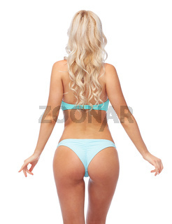 woman in bikini swimsuit from back