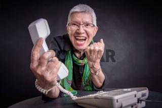 Terrible service, angry senior woman yelling at phone