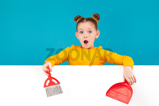surprised girl with a red scoop and brush