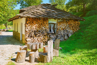 Small House with Stacked Firewood