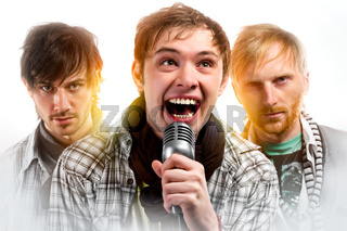 Portrait of three handsome musicians over white background