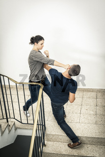 young woman fighting with man