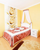 Beautiful classical bedroom interior in yellow colors