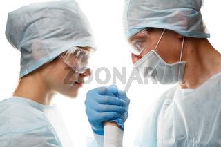 Doctors in uniform make handshake