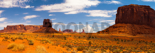 Panorama landscape - Iconic peaks of rock formations in the Navajo Park of Monument Valley