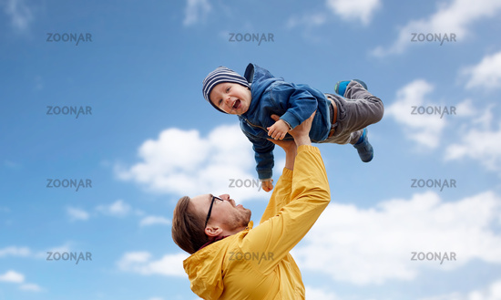 father with son playing and having fun outdoors
