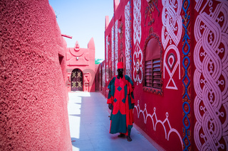 Exterior view to Damagaram sultan residence and portrait of sultans guard in national uniform , Zinder, Niger