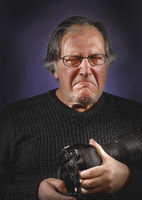 old freelance photographer suspicious of his imminent future