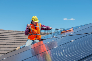 worker and solar panels