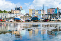 Boats in the bay at low tide with town view in Tenby bay, Wales