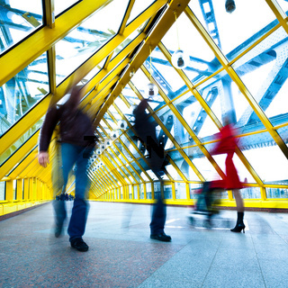 People silhouettes in motion in yellow passage